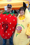 Man and woman wear strawberry and banana costumes in front of Jamba Juice shop. Grand Old Day Festival. St Paul Minnesota MN USA