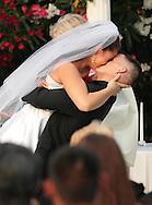 Photographer: Kevin Bartram.Senft-Kreutzinger 06-27-2008.Mayumi Senft and Evan Kreutzinger share their first kiss at The Nines in Brentwood, California.