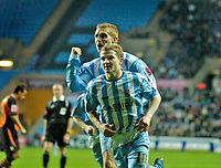 Photo: Leigh Quinnell.<br /> Coventry City v Ipswich Town. Coca Cola Championship.<br /> 19/11/2005. James Scowcroft helps Gary McSheffrey celebrate his goal for Coventry.