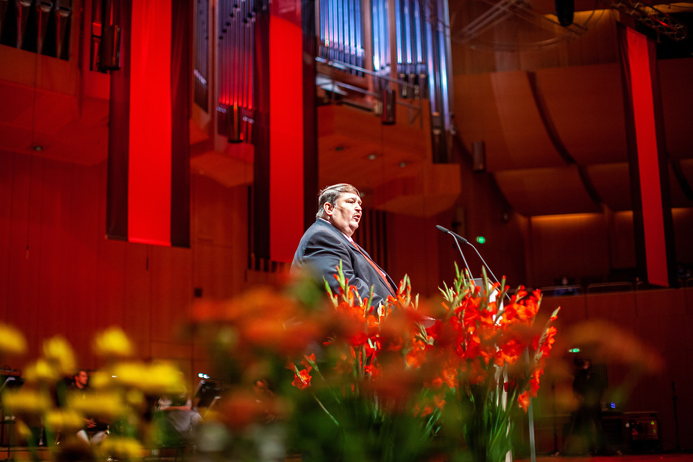 """Bernd Posselt - the spokesman for the Sudeten German ethnic group and federal chairman of the Sudeten German Landsmannschaft - speaking at the ceremony including the awarding of the European Charles Prize  during the 71st Sudeten German meeting at the """"Philharmonie im Gasteig"""" in Munich."""