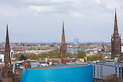 Coventry City Skyline including the famous three spires and the blue exterior of the Wave leisure centre in Coventry on the 28th of April 2021, Coventry, United Kingdom.