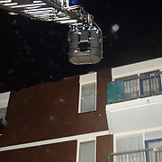 Stormschade Eek Huizen, dak flat los gewaaid, brandweer ladderwagen 751, regen