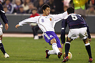 10 February 2006: Japan's Mitsuo Ogasawara (8) plays the ball while being defended by Kerry Zavagnin (5), of the United States. The United States Men's National Team defeated Japan 3-2 at SBC Park in San Francisco, California in an International Friendly soccer match.