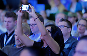 A small business attendee captures the action at Facebook's Boost Your Business Nashville event held at Marathon Music Works on Thursday, Aug. 27, 2015, in Nashville, Tenn. (Photo by Wade Payne/Invision for Facebook/AP Images)