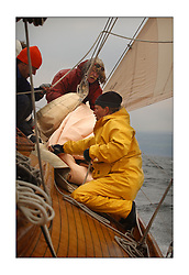 Solway Maid, a 53' Burmudan Cutter the last of the boast to be built at the Fife yard. Here racing on the sunday's race to Helensburgh...Renee and Chuck on the bow during a headsail change...This the largest gathering of classic yachts designed by William Fife returned to their birth place on the Clyde to participate in the 2nd Fife Regatta. 22 Yachts from around the world participated in the event which honoured the skills of Yacht Designer Wm Fife, and his yard in Fairlie, Scotland...FAO Picture Desk..Marc Turner / PFM Pictures