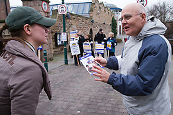 Man talking to a passer by on an official PCS picket,