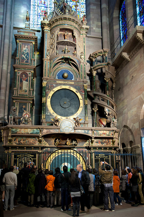 Tourists view Strasbourg Astronomical Clock in South Transept of Cathedral of Notre Dame, Our Lady, at Strasbourg, Alsace, France