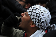 London 04/01/09: Protests outside the Israeli Embassy in London UK:  A young man uses a loud hailer to make himself heard