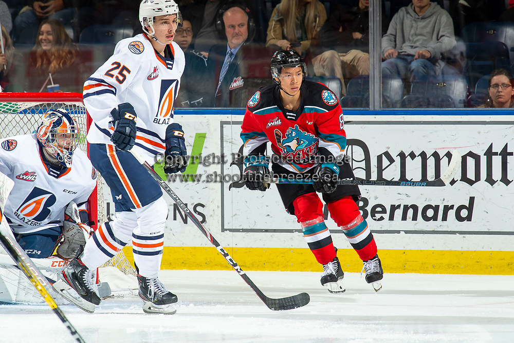 KELOWNA, BC - NOVEMBER 16: Trevor Wong #8 of the Kelowna Rockets looks for the pass to shoot on the net of Dylan Garand #31 of the Kamloops Blazers at Prospera Place on November 16, 2019 in Kelowna, Canada. (Photo by Marissa Baecker/Shoot the Breeze)