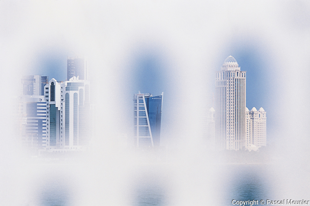 """QATAR. Doha. Business District. Miracle or mirage ?..""""Seven years ago, there was no tower in this part of the city"""", the inhabitants tell us. Today, this district is rapidly expanding with towers higher and higher."""