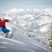 Katie Mansfield and Jack Bentley skiing powder at Northstar Mountain Resort.