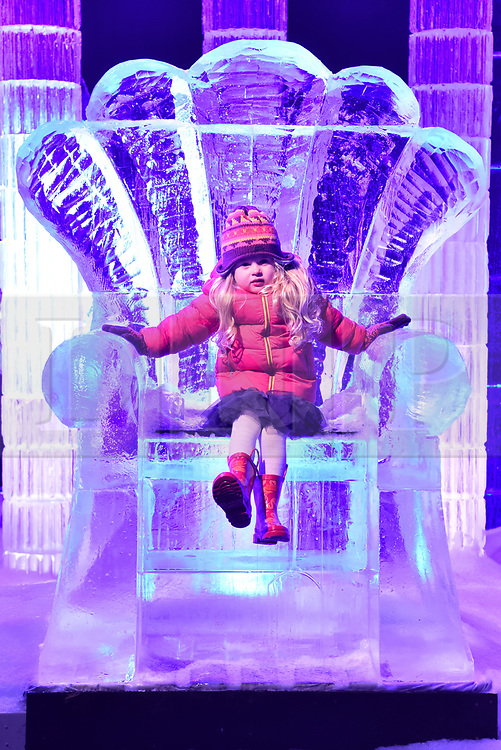 © Licensed to London News Pictures. 16/11/2017. London, UK. Ruby Darrah aged 3 sits on the throne of a large ice sculpture on display as part of the Deep Sea Adventure. The Magical Ice Kingdom is the largest indoor ice and snow sculpture experience in Europe and part of the Hyde Park Winter Wonderland. Photo credit: Ray Tang/LNP