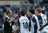 Photo: Andrew Unwin.<br />Newcastle United v Tottenham Hotspur. The Barclays Premiership. 01/04/2006.<br />Tottenham players surround the referee, Mike Dean (L), following the sending off of Michael Dawson (R).