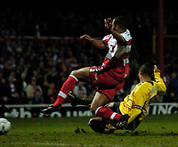 Photo: Jed Wee.<br /> Doncaster Rovers v Arsenal. Carling Cup. 21/12/2005.<br /> <br /> Arsenal's Gilberto Silva (R) prods home a goal in injury time in extra-time to take the game to a penalty shootout.