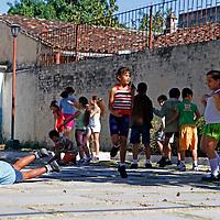 Central America, Cuba, Santa Clara. Kids on playground in Santa Clara.