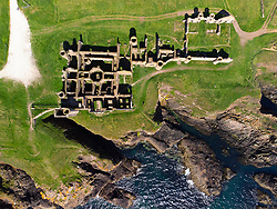Aerial view from drone of Slains Castle on cliffs above Moray Firth near Cruden Bay in Aberdeenshire, Scotland, UK