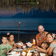 Family has a Romantic tropical candlelight dinner after dark, El Nido, Palawan, Philippines