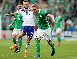 Northern Ireland's George Saville (right) and Bosnia and Herzegovina's Elvis Saric battle for the ball the UEFA Nations League, League B Group Three match at Windsor Park, Belfast.