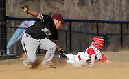 Chester, New York  - A baserunner slides into third base as the infielder applies the tag during the TRUMP March Madness youth baseball tournament at The Rock Sports Park on March 17, 2012.