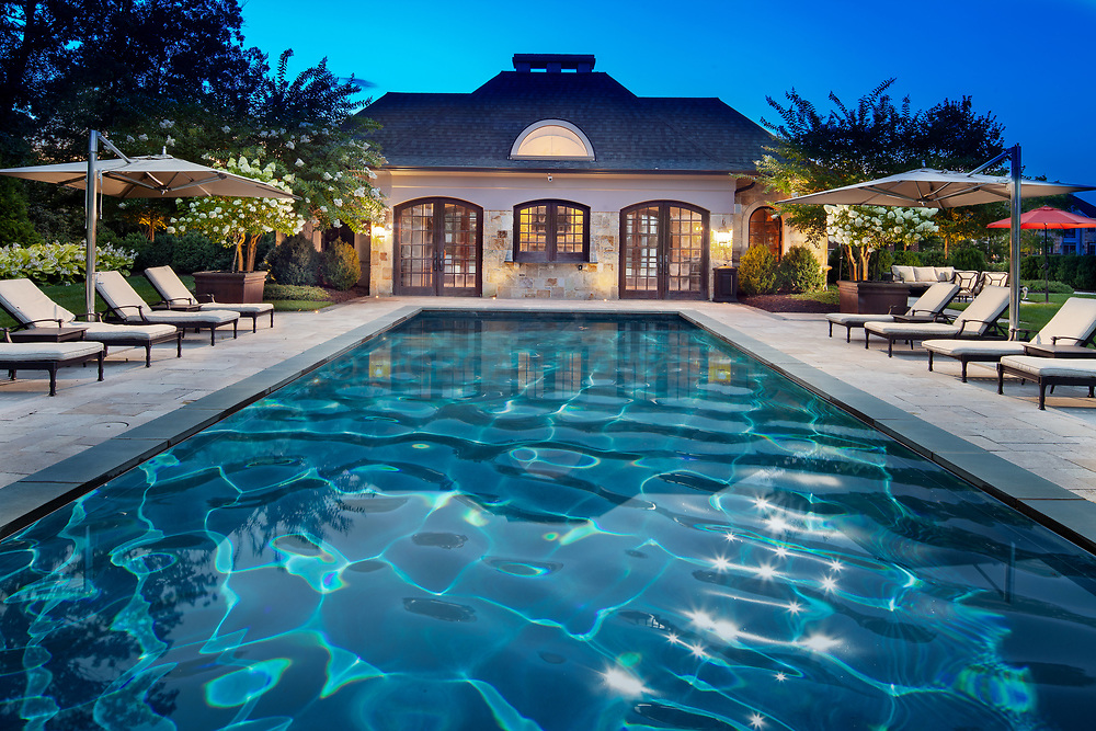 1610 Admiral Hill exterior landscaping with pool and twilight