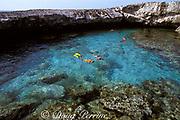 snorkelers visit Water Cay,<br /> Cay Sal Bank, <br /> Bahamas ( Western Atlantic Ocean ) MR 144-146