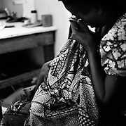 A victim with a baby cries as she described the rape to a counselor at Rutshuru Hospital in North Kivu. The victim was treated with thorough counseling and an antibiotic injection, which is provided by MSF France.