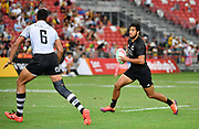 New Zealand's Regan Ware runs at Fiji's Meli Derenalagi his sides 19-5 defeat during the HSBC Singapore Rugby Sevens Cup Quarter Final - New Zealand v Fiji at The National Stadium, Singapore, Sunday, April 13th, 2019. (Steve Flynn/Image of Sport)