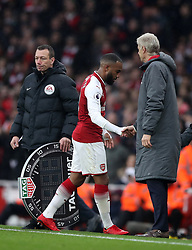 Arsenal's Alexandre Lacazette shakes hands with his manager Arsene Wenger as he is substituted