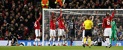 Manchester United players appeal after CSKA Moscow's Alan Dzagoev (left) scores his side's first goal during the UEFA Champions League match at Old Trafford, Manchester.