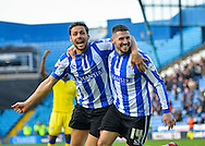 Sheffield Wednesday Defender Vincent Sasso and Sheffield Wednesday Forward Gary Hooper celebrate during the Sky Bet Championship match between Sheffield Wednesday and Leeds United at Hillsborough, Sheffield, England on 16 January 2016. Photo by Adam Rivers.