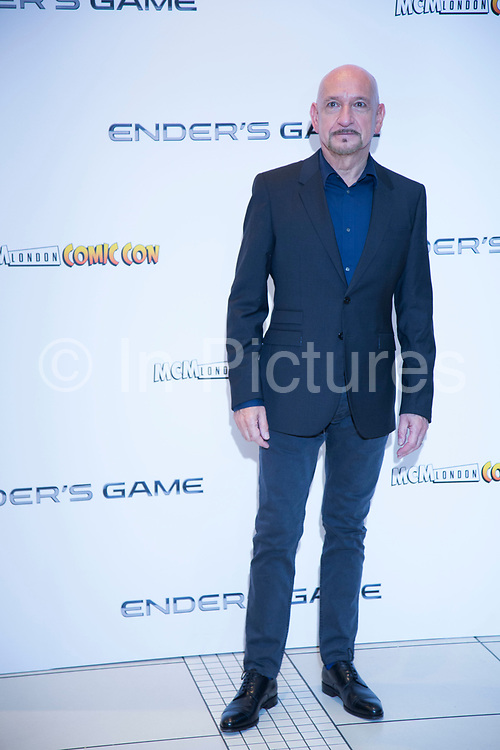 London, UK. Monday 7th October 2013. Sir Ben Kingsley. Press call for Ender's Game, an epic adventure based on the best-selling, award winning novel. Written and directed by Academy Award winner Gavin Hood.