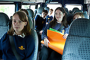 STEM club members travelling by minibus to make a presentation at the Okehampton Primary School assembly - one of the 11 feeder Primary schools the College has worked with to introduce sustainable energy. The school has just had PV solar panels installed and the theme will be 'not to waste the energy they are now making for themselves'.Okenhampton College, Devon.