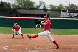 15 April 2012:  Pitcher Jordan Birch winds up to make a pitch during an NCAA women's softball game between the Drake Bulldogs and the Illinois State Redbirds on Marian Kneer Field in Normal IL