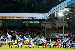 the teams od De Graafschap and MVV Maastricht enter the pitch during the Jupiler League match between De Graafschap and MVV Maastricht at the Vijverberg stadium on September 08, 2017 in Doetinchem, The Netherlands