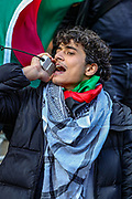 London, United Kingdom, May 22, 2021: A passionate egyptian protestor addresses a rally outside the Israeli Embassy in Kensington, London during a pro-Palestinian rally on Saturday May 22, 2021. Egyptian mediators held talks Saturday to firm up an Israel-Hamas cease-fire as Palestinians in the Hamas-ruled Gaza Strip began to assess the damage from 11 days of intense Israeli bombardment. (Photo by Vudi Xhymshiti/VXP)