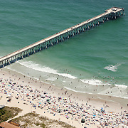 The 4th of July means celebration - and for those around Wrightsville Beach, NC, the beach is the palce to go. Here crowds gather around Johnie Mercer's Pier.