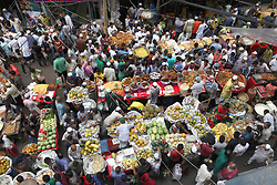 May 28, 2017 - Dhaka, Bangladesh - May 28, 2017 - Dhaka, Bangladesh - People gather to buy foods for breaking their fast during the Muslims holy fasting month of Ramadan at the traditional food market popular for different kinds of Kebab, chicken roast, fruits and sweets at chawkbazar old part of Dhaka, Bangladesh 28 May 2017. Muslims around the world celebrate the holy month of Ramadan by praying during the nighttime and abstaining from eating, drinking, and sexual acts daily between sunrise and sunset. Ramadan is the ninth month in the Islamic calendar and it is believed that the Koran's first verse was revealed during its last 10 nights. © Monirul Alam (Credit Image: © Monirul Alam via ZUMA Wire)
