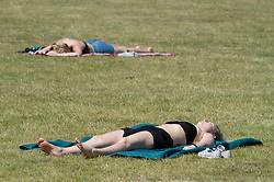 ©Licensed to London News Pictures 21/05/2020<br /> Greenwich, UK. Sunbathers in the park. People out and about in Greenwich park, Greenwich, London this afternoon enjoying lockdown freedom as the mini heatwave hot weather continues with temperatures set to hit 28C in parts of the UK.  Photo credit: Grant Falvey/LNP