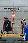 The Wintershall Players open-air re-enactment of 'The Passion of Jesus' on Good Friday in the rain in Trafalgar Square. It featured a cast of over 100 volunteers from in and around London.