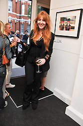CHARLOTTE TILBURY at a private view of an exhibition of photographs by Mike Figgis entitled 'Kate & Other Women' held at The Little Black Gallery, 13 A Park Walk, London SW10 on 22nd June 2011.