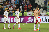 FOOTBALL - UEFA EURO 2012 - DONETSK - UKRAINE  - 1/4 FINAL - SPAIN v FRANCE - 23/06/2012 - PHOTO PHILIPPE LAURENSON /  DPPI - GAEL CLICHY (FRA) / ANTHONY REVEILLERE (FRA) / KARIM BENZEMA (FRA) DESPAIR AFTER MATCH