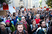 "Angry protesters shout slogans at Occupy London protest, October 15th 2011. Protest spreads from the US with this demonstrations in London and other cities worldwide. The 'Occupy' movement is spreading via social media. After four weeks of focus on the Wall Street protest, the campaign against the global banking industry started in the UK this weekend, with the biggest event aiming to ""occupy"" the London Stock Exchange. The protests have been organised on social media pages that between them have picked up more than 15,000 followers. Campaigners gathered outside  at midday before marching the short distance to Paternoster Square, home of the Stock Exchange and other banks.It is one of a series of events planned around the UK as part of a global day of action, with 800-plus protests promised so far worldwide.Paternoster Square is a private development, giving police more powers to not allow protesters or activists inside."