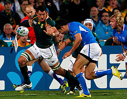 South Africa Springboks' Pierre Spies (L) fends off Namibia's Danie Van Wyk during their Rugby World Cup Pool D match at North Harbour Stadium in Auckland September 22, 2011. REUTERS/Mike Hutchings (NEW ZEALAND  - Tags: SPORT RUGBY)