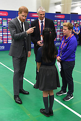 The Duke of Sussex speaks to children as he attends the opening match of the 2019 ICC Cricket World Cup between England and South Africa at The Oval in London.