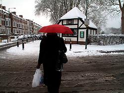 UNITED KINGDOM LONDON 2FEB09 - A lone pedestrian walks through snowfall and white streets  in Queens Park, west London...jre/Photo by Jiri Rezac..© Jiri Rezac 2009