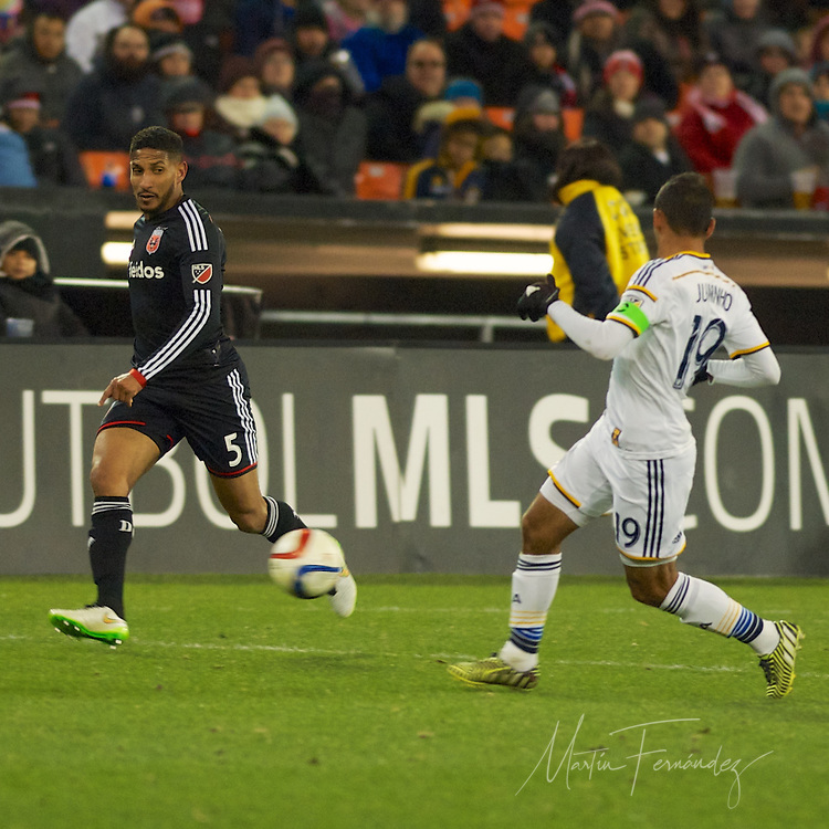 DC United's Sean Franklin puts a cross past LA's Juninho. DC United defeated the LA Galaxy 1-0 with a stoppage time goal from Chris Pontius at RFK Stadium in Washington DC.