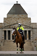 MELBOURNE, VIC - SEPTEMBER 12: A mounted Police Officer stands ready at The Shrine during the Melbourne Freedom Walk Rally on September 12, 2020 in Melbourne, Australia. Stage 4 restrictions are in place from 6pm on Sunday 2 August for metropolitan Melbourne. This includes a curfew from 8pm to 5am every evening. During this time people are only allowed to leave their house for work, and essential health, care or safety reasons. Despite this, multiple protests are being arranged to push back against the draconian restrictions in place within metropolitan Melbourne. A Freedom Walk was arranged to take place in the Tan but with hundreds of police and wet weather forecast, only a small number of protesters tried to attend before being ordered to move on. (Photo by Dave Hewison/Speed Media)