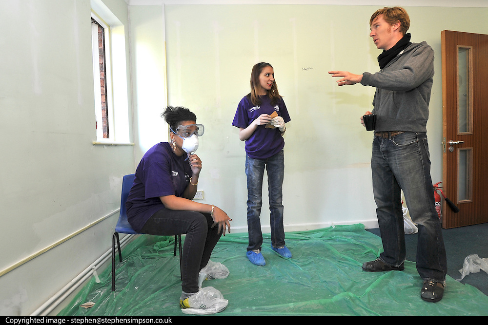 ©INS News Agency Ltd...  19/10/2010.Benedict Cumberbatch speaks to some of the volunteers..Benedict Cumberbatch helps out with the Prince's Trust 'Make a Change Week' by helping decorate classrooms at Cricket Green School in Mitcham London.