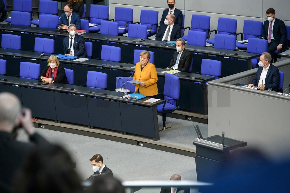 24 MAR 2021, BERLIN/GERMANY:<br /> Angela Merkel (M), CDU, Bundeskanzlerin, waehrend der Regierungsbefragung durch den Bundestag zur Bekaempfung der Corvid-19 Pandemie, Plenarsaal, Reichstagsgebaeude, Deutscher Bundestag<br /> IMAGE: 20210324-01-007<br /> KEYWORDS: Corona