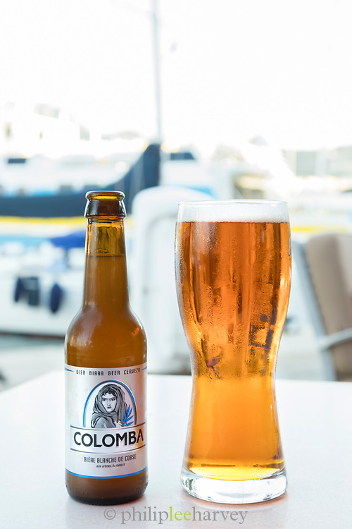 Close up of beer in glass and in bottle, Calvi, Corsica, France